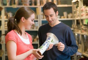 Couple purchasing porcelain vase