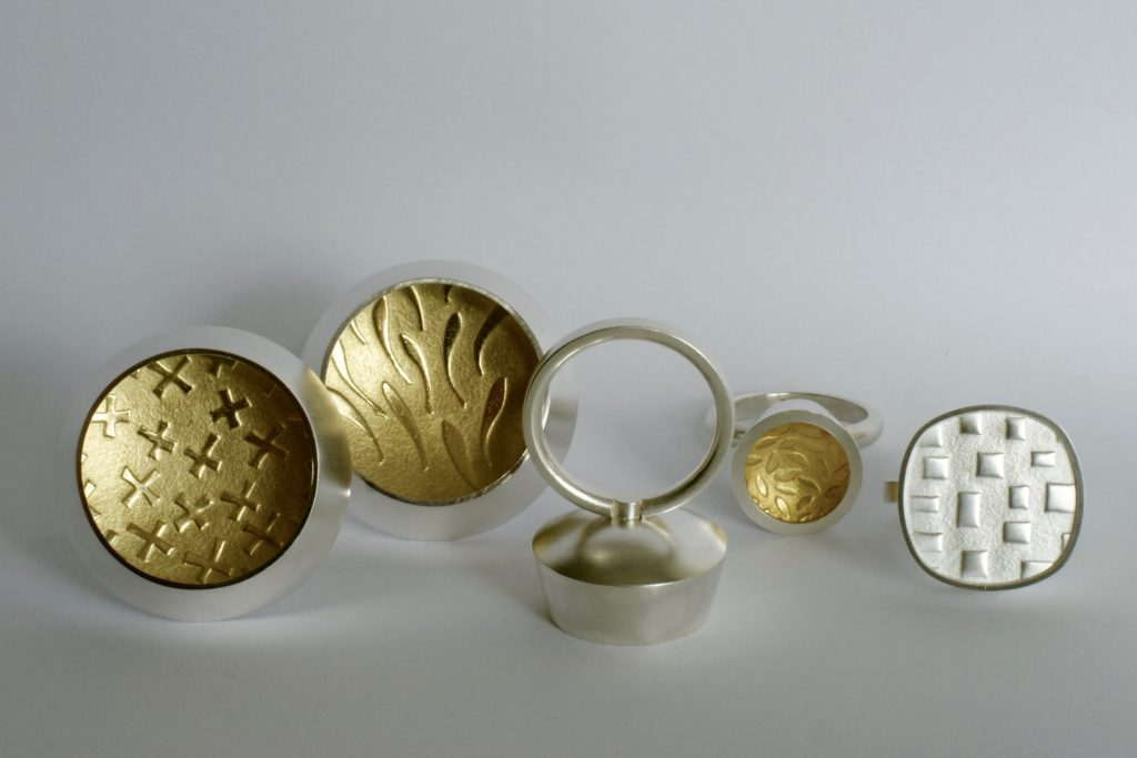 Inga Reed rings in embossed silver and 22 carat gold